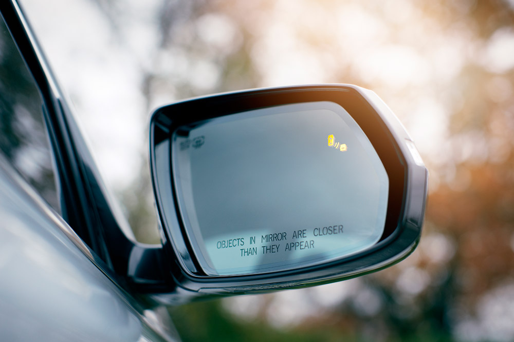 adjust car mirrors