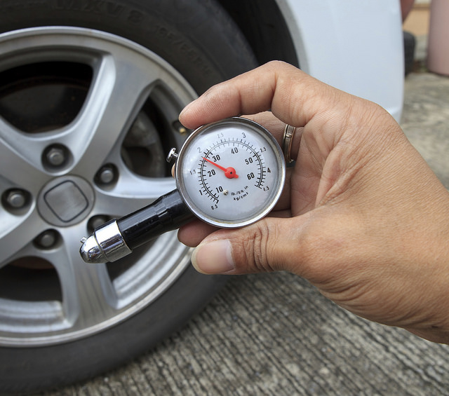 You can check your tire pressure with a tire pressure gauge